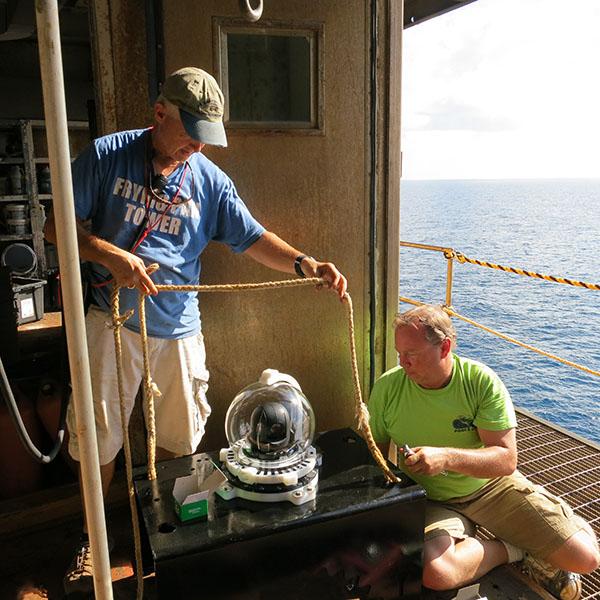 Volunteers Cleaning Underwater Camera